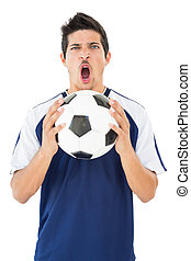 Portrait of a football player shouting
