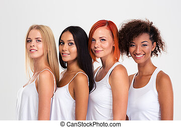 Portrait of a four smiling multi ethnic women