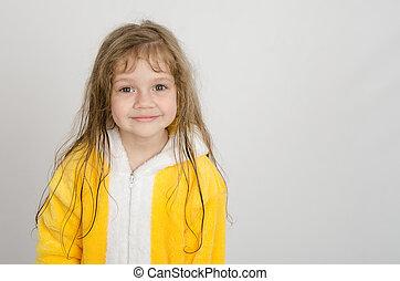 Portrait of a four-year girl in bathrobe