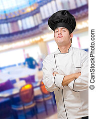 Portrait Of A Funny Chef With Hands Folded at a restaurant