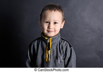 portrait of a funny little boy 3-4 year old