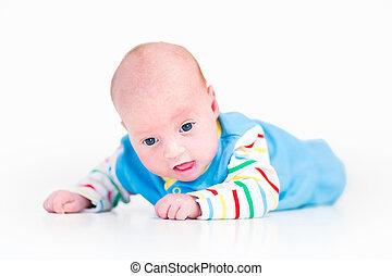 Portrait of a funny newborn baby boy