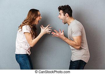 Portrait of a furious young couple having an argument