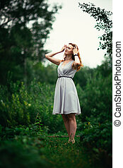 portrait of a girl against a nature background