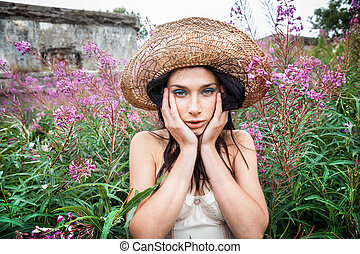 girl against background of nature and old concrete wall