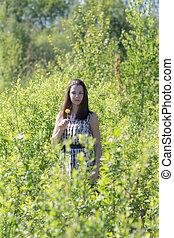girl among green plants