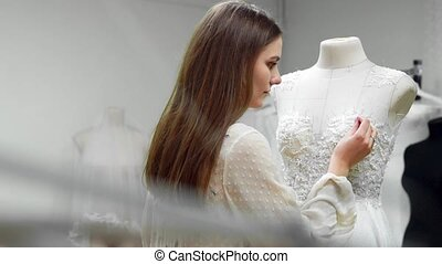 Portrait of a girl creating a wedding dress by exclusive...