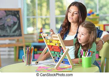 girl doing math exercises - Portrait of a girl doing math...