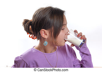 Portrait of a  girl drinking a glass of milk