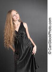Portrait of a girl in a black dress