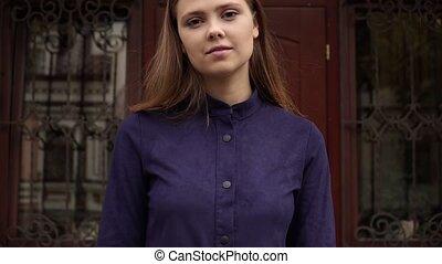 Portrait of a girl in a blue dress