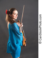 girl in a blue dress with a violin