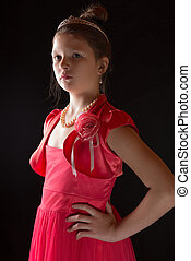 Portrait of a girl in a dress on black background