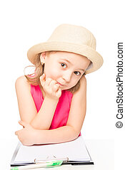 portrait of a girl in a hat with a notebook on a white background isolated