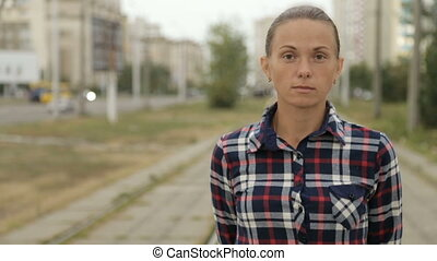 Portrait of a girl in a plaid shirt - Portrait of a woman in...