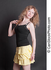 portrait of a girl in a yellow skirt