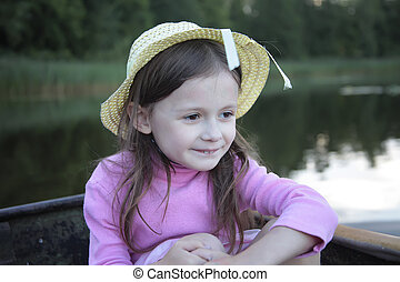 Portrait of a girl in boat on the lake