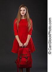 Portrait of a girl in red dress