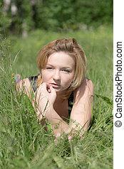 girl in summer green grass
