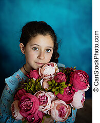 portrait of a girl in the studio with flowers