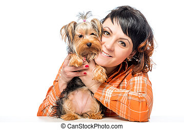 portrait of a girl in the studio with Yorkshire Terrier