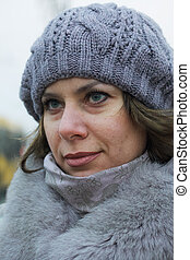 Portrait of a girl in winter clothes. Close-up shot.