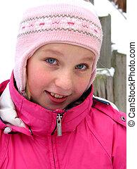 Portrait of a girl in winter hat