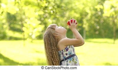 Portrait of a girl kissing vegetabl
