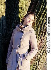 girl near a tree
