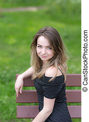 portrait of a girl on a bench