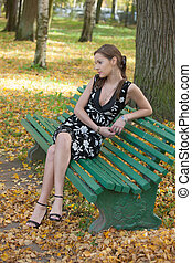 girl on a bench in autumn