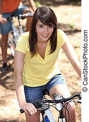 portrait of a girl on a bike