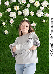 girl on a green background with flowers