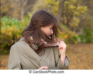 girl on a windy autumn day