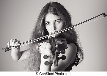 Portrait of a girl playing the violin