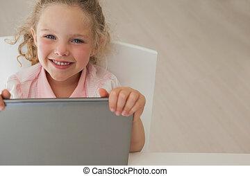Portrait of a girl using digital tablet