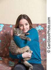 girl with a cat on the couch