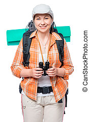 portrait of a girl with a large tourist backpack and binoculars on a white background