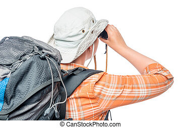 portrait of a girl with binoculars, view from the back on a white background