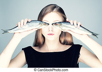 Portrait of a girl with fish