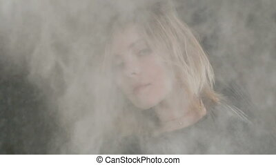 Portrait of a girl with flying white powder or dust....