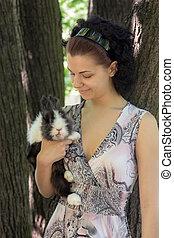 girl with her beloved pet rabbit