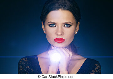 portrait of a girl with led flashlight