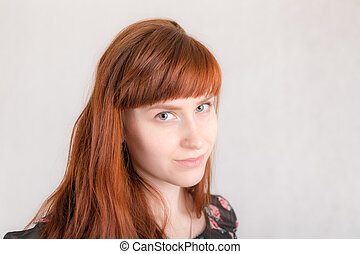 girl with long red hair closeup