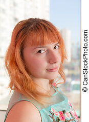 girl with red hair closeup