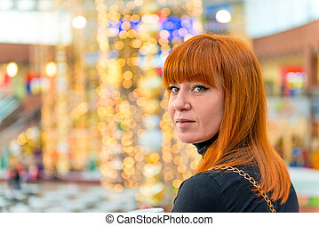 portrait of a girl with red hair in the mall