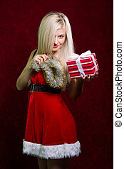 Portrait of a girl with Santa striped gift.