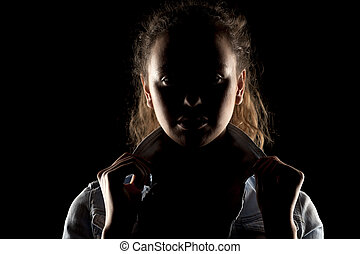 a girl with the face in shadow