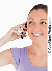 Portrait of a good looking female on the phone while standing