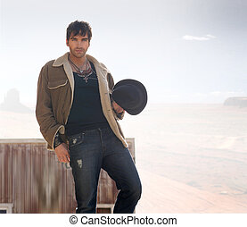 Portrait of a good-looking male model with desert behind